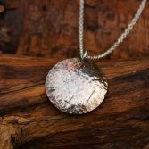 Hammer Copper Disc Pendant With Fine Silver Melted One Side.